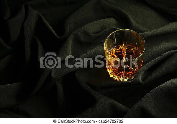 Whiskey on black cloth - csp24782702