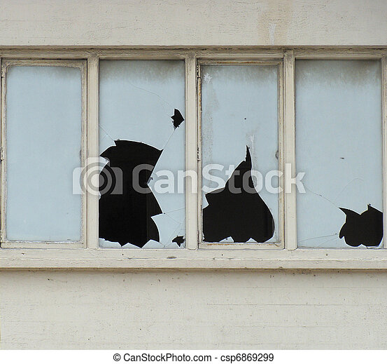 white abandoned concrete building with broken windows - csp6869299