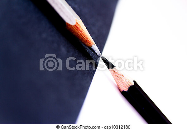 White And Black Pencils Facing Each Other On Opposite Color Background Depicting Contrast Stock Photo