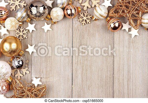 white and gold christmas ornament corner border on wood christmas