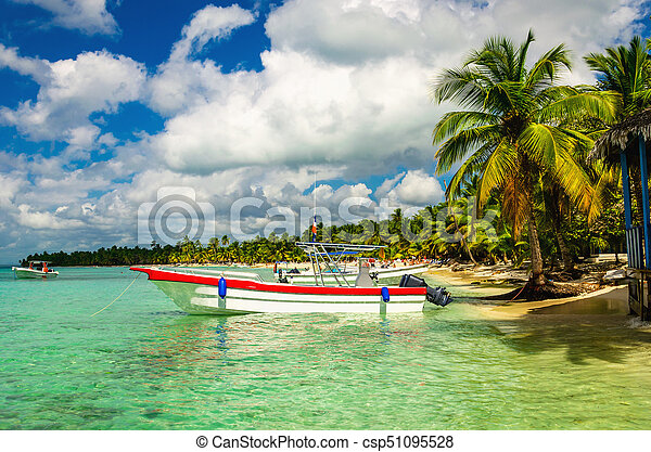 White and red boat on shore of Caribbean Islands, Dominican Republic - csp51095528