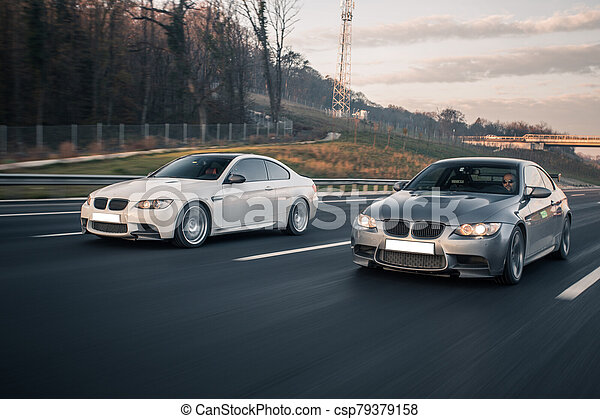 White and silver sport sedan cars on the road - csp79379158