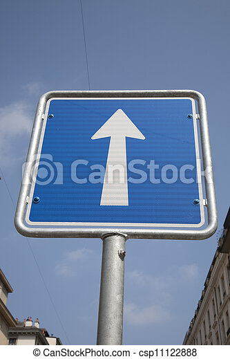 White Arrow One Way Sign on Blue Sky Background - csp11122888