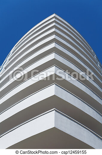 white balconies of a modern residential building on a clear blue sky - csp12459155
