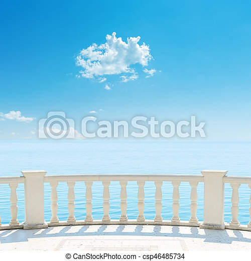 white balcony near sea and blue sky with cloud over it - csp46485734