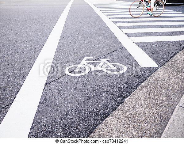 White bicycle sign on street in Japan. - csp73412241