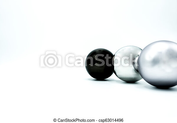White, black and silver christmas balls on white. - csp63014496