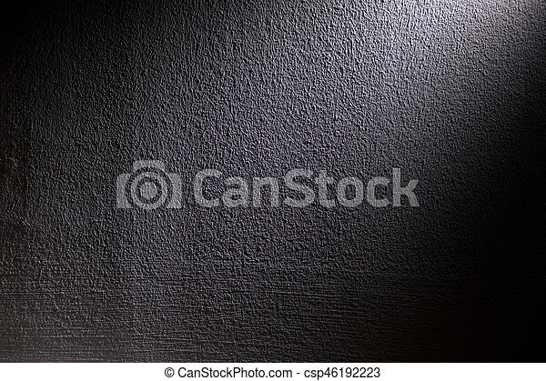 White, blur spotlight effect on black background. Concrete wall. - csp46192223