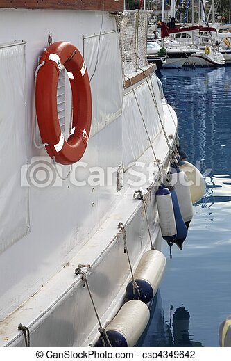 white boat side with fender and round lifesaver white boat stock