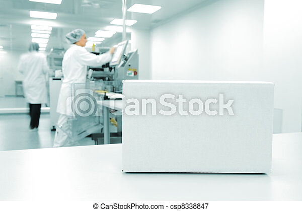 White box at automated production line at modern factory, people working in background - csp8338847