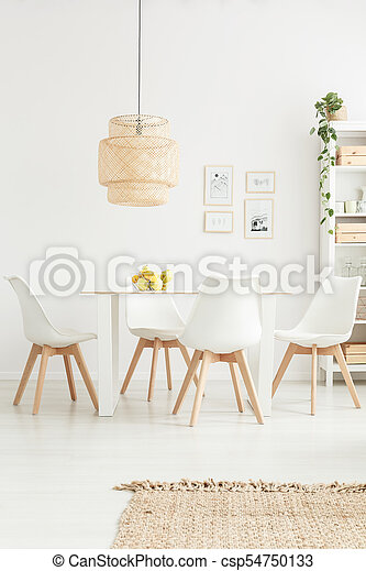 White chairs in bright room - csp54750133