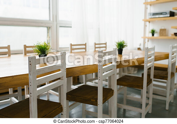 white chairs with a brown seat in the kitchen or dining room in Scandinavian style - csp77064024