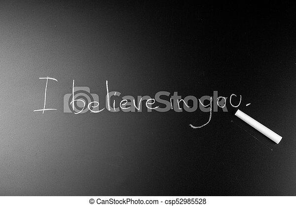 White chalk Write text on a blackboard - csp52985528