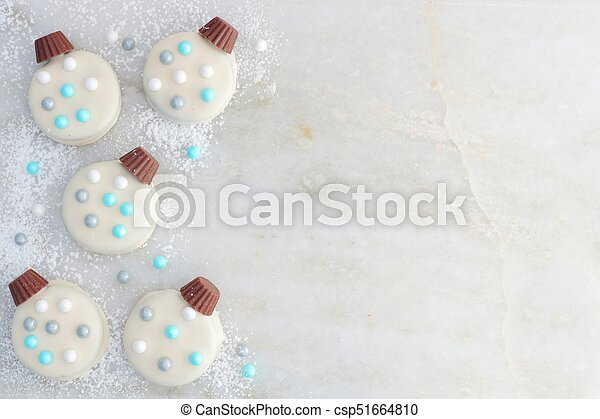 White Chocolate Christmas Ornament Cookies Side Border On Marble