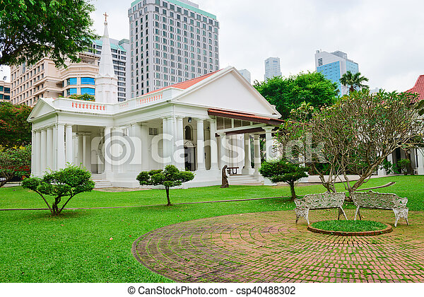 White christian church in green garden. White armenian church of ...