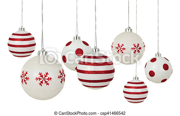white christmas balls with painted red patterns hanging in a row isolated on white background