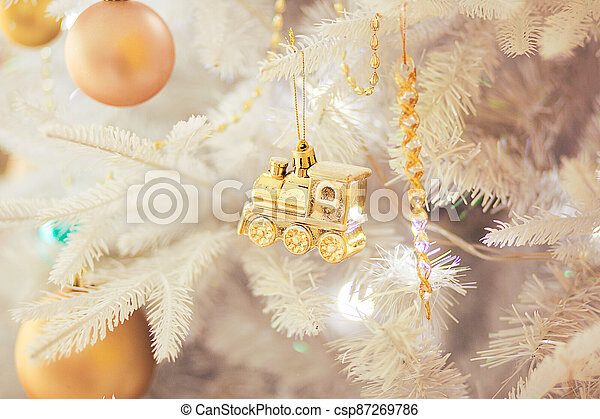 White Christmas tree with gold christmas ornament, close up - csp87269786