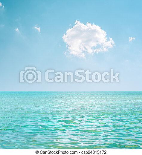 white cloud in blue sky over sea - csp24815172