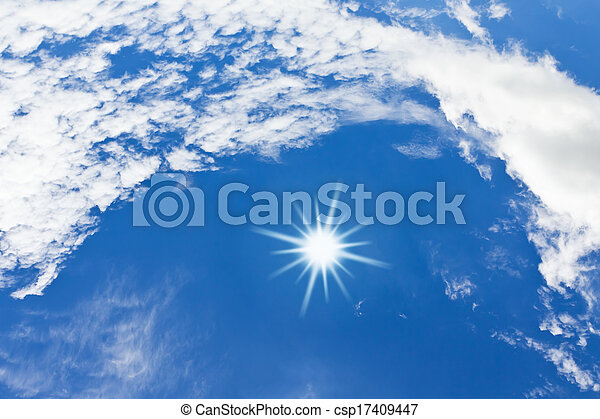 White clouds and sun over blue sky - csp17409447