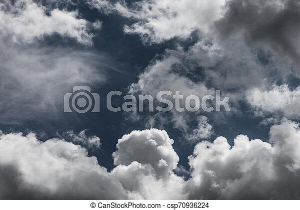 white clouds on dark blue sky background - csp70936224