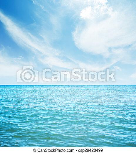 white clouds over blue sea - csp29428499