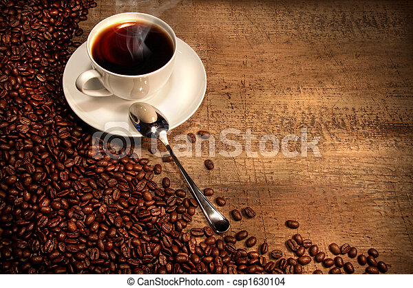 White coffee cup with beans on rustic table - csp1630104