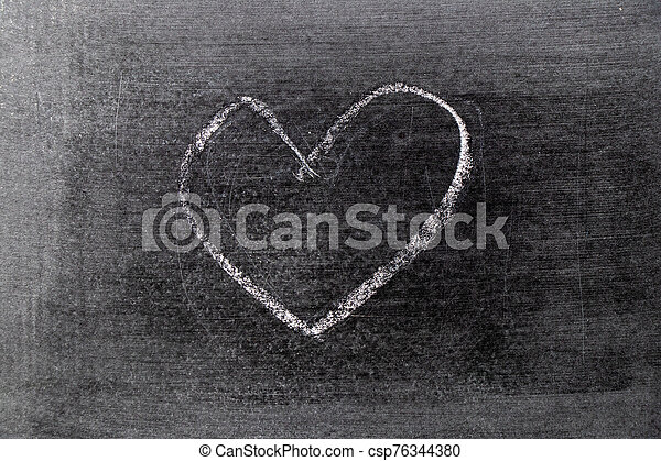 White color chalk hand drawing in heart shape on blackboard background - csp76344380