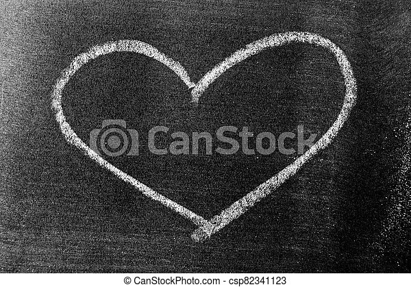 White color chalk hand drawing in heart shape on blackboard background - csp82341123