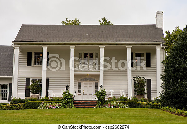 White columned two story house An old white colonial house stock