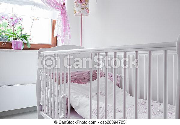 White crib in nursery room - csp28394725