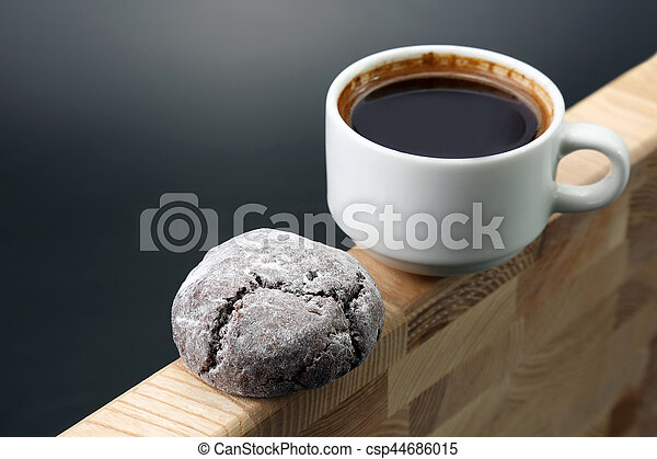 white Cup of black coffee with biscuits on a wooden frame - csp44686015