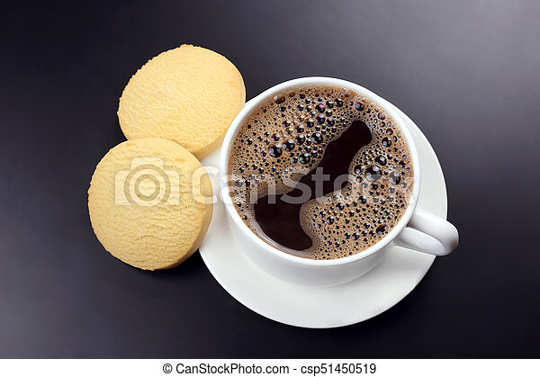 white cup of black coffee with biscuits on a dark background - csp51450519