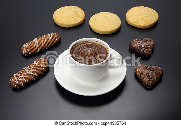 white cup of black coffee with biscuits on a dark background - csp44335764