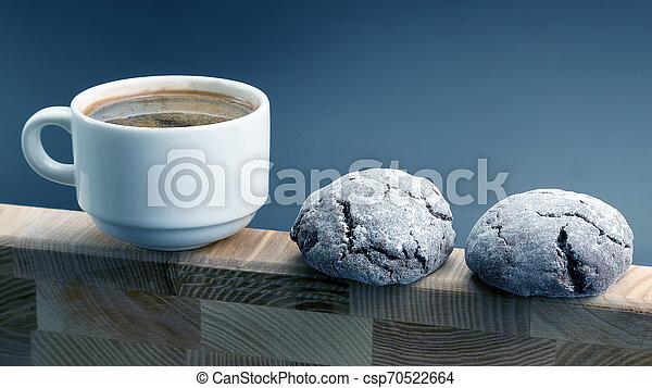 white Cup of black coffee with biscuits on a wooden frame - csp70522664