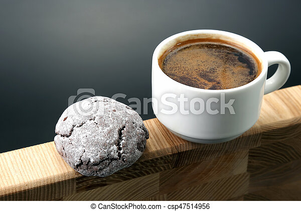 white Cup of black coffee with biscuits on a wooden frame - csp47514956