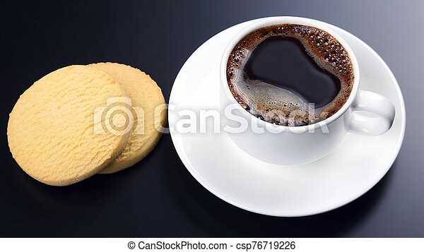 white cup of black coffee with biscuits on a dark background - csp76719226