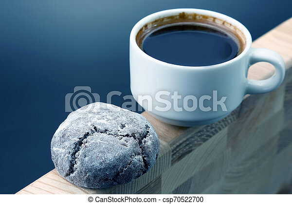 white Cup of black coffee with biscuits on a wooden frame - csp70522700