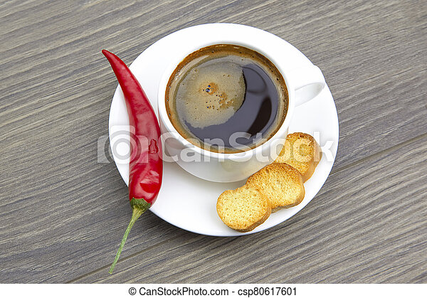 white Cup of black coffee with biscuits on a wooden frame - csp80617601