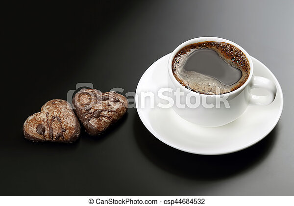 white cup of black coffee with biscuits on a dark background - csp44684532