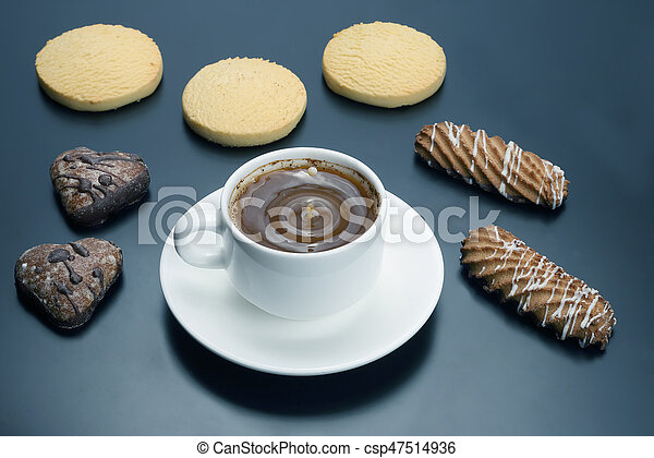 white cup of black coffee with biscuits on a dark background - csp47514936