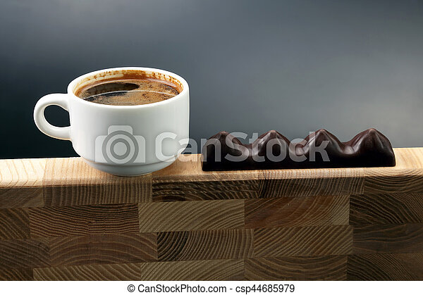 white Cup of black coffee with chocolate on a wooden frame - csp44685979