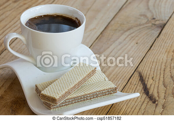 White cup of black coffee with chocolate wafers - csp51857182