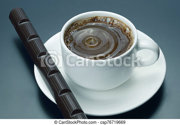 white Cup of black coffee with chocolate - csp76719669