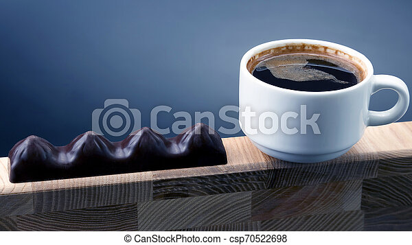 white Cup of black coffee with chocolate on a wooden frame - csp70522698