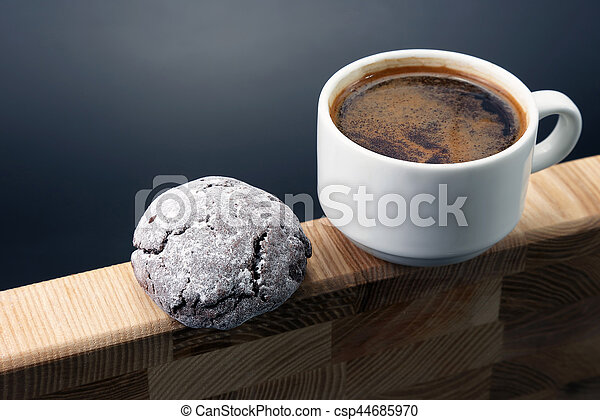 white Cup of black coffee with cookies on wooden - csp44685970