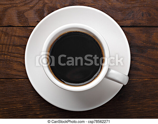white cup of coffee on a wooden - csp78562271