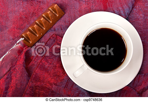 White cup of coffee with chocolate - csp9748636