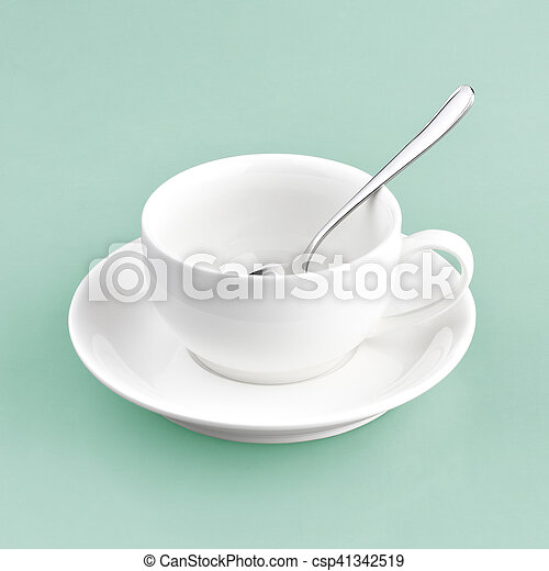 white cup on green blue background - csp41342519