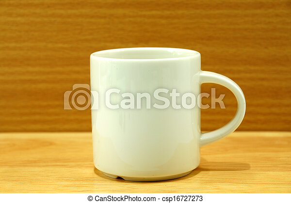 White cup on wood background - csp16727273