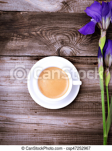 White cup with black coffee on a gray wooden surface - csp47252967
